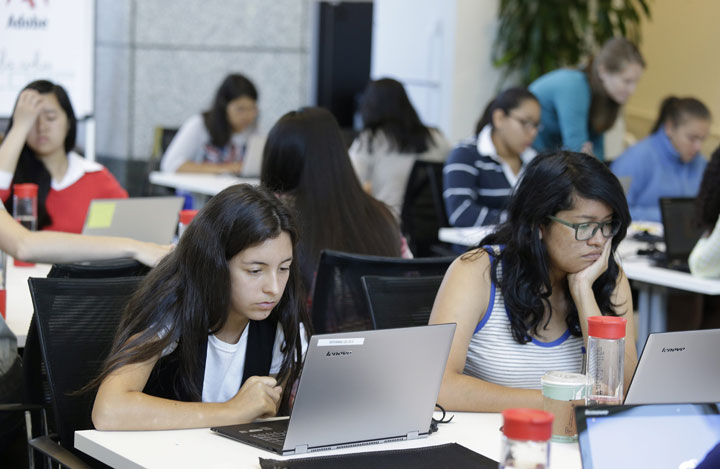 Bryanna Gilges, 15, left, and Yvonne Gonzalez, 17, right, work at completing an exercise during a Girls Who Code class at Adobe Systems in San Jose, Calif. The program aims to inspire and equip young women for futures in the computing-related fields.
