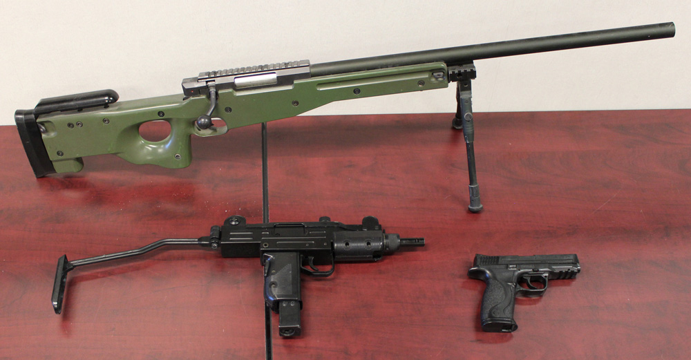 A file photo of three types of airsoft guns (long gun, assault weapon, and pistol).