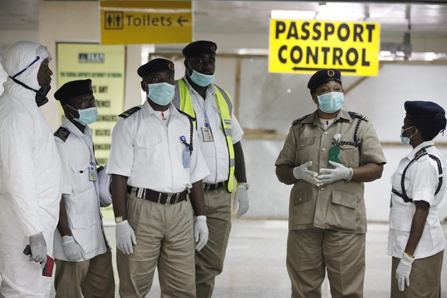 Nigeria health officials wait to screen passengers at the arrival hall of Murtala Muhammed International Airport in Lagos, Nigeria, Monday, Aug. 4, 2014.