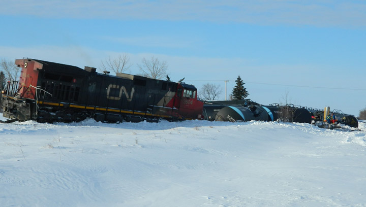 Transportation Safety Board says diminished train horn contributed to fatal 2013 crossing crash that killed grader operator, derailed 16 tank cars.