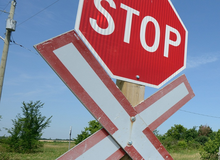 A stop sign and a railroad crossing sign.