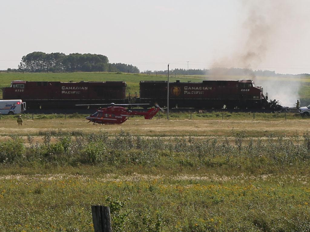 Emergency crews responded to a train fire and derailment west of Moose Jaw Monday afternoon.