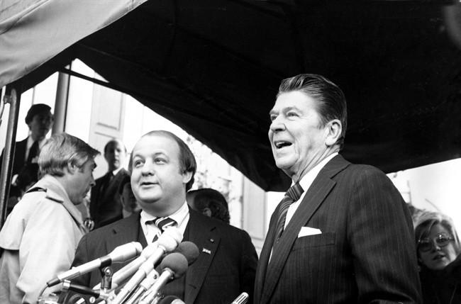 This Jan. 6, 1981 file photo shows President-elect Ronald Reagan introducing James Brady as his press secretary in Washington. (AP Photo/Walt Zebowski, File) .