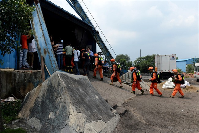 In this Aug. 19, 2014 photo, rescuers prepare to go into the Dongfang Coal Mine in Xiejiaji District of Huainan City, east China's Anhui Province. On Sept. 27, 2016, another explosion occurred -- this time at a small coal mine in the city of Shizuishan in the northwestern region of Ningxia, the official Xinhua News Agency said.