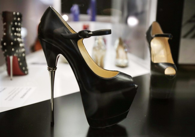 A pair of 2013 Christian Louboutin shoes is on display at an exhibit at the Brooklyn Museum in New York on Sept. 4, 2014.