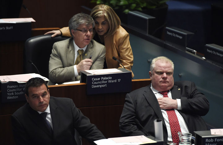 From left are Councillor Giorgio Mammoliti, Cesar Palacio, Councillor Frances Nunziata and Toronto Mayor Rob Ford, during a council meeting on April 1 2014 for debate on a proposal that would expand Billy Bishop City Centre Airport.