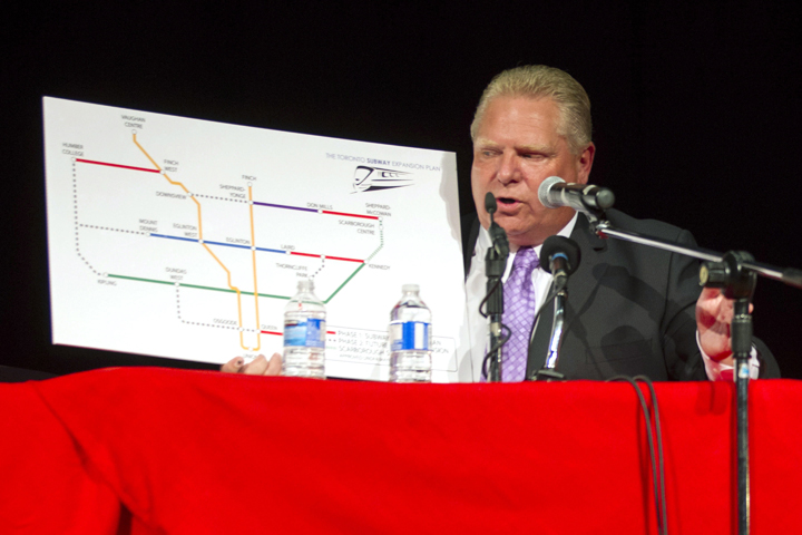 Doug Ford holds a board detailing his transit plan as he takes part in a Toronto Mayoral Debate with John Tory and Olivia Chow in Toronto on Tuesday, September 23, 2014.