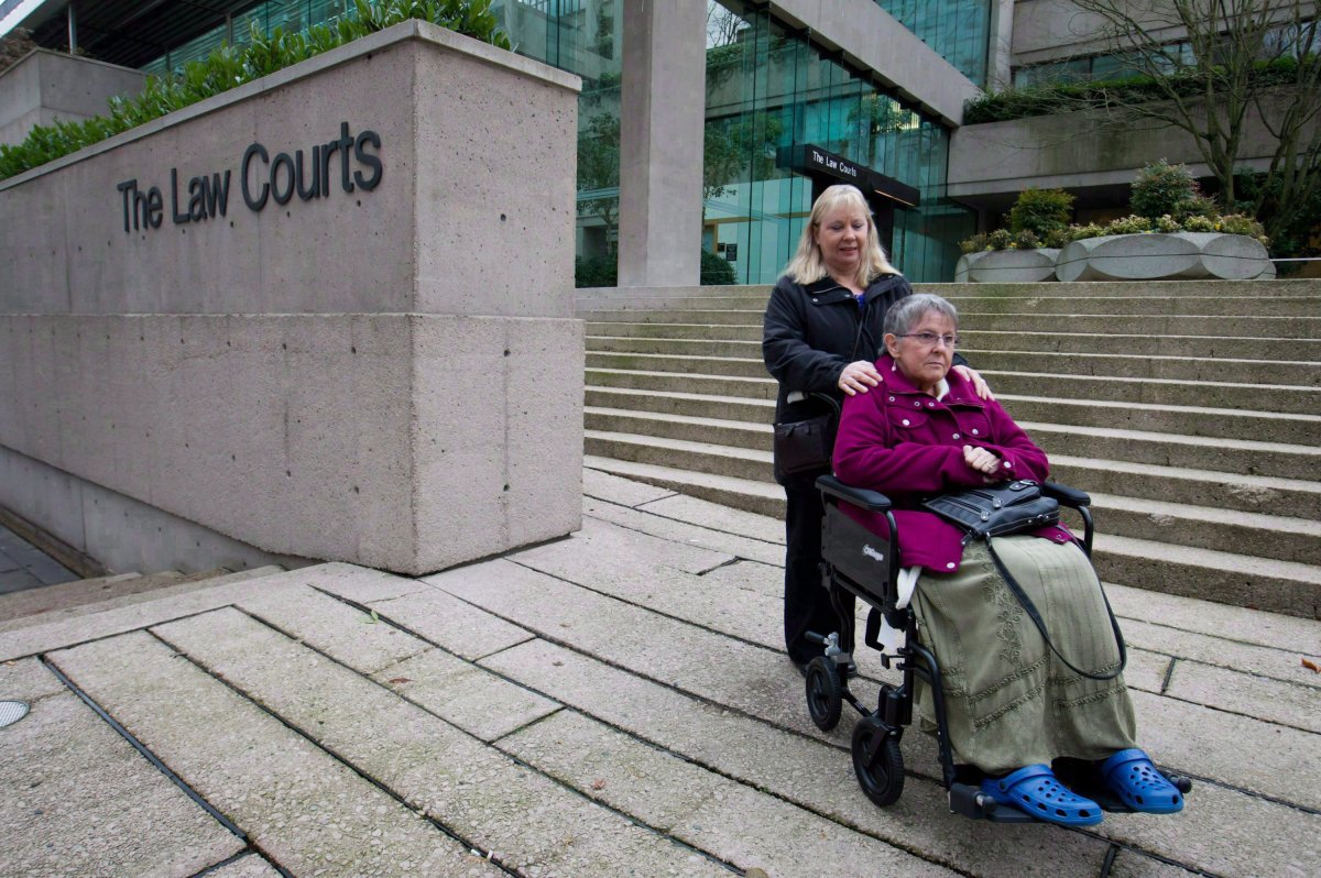Gloria Taylor, right, is assisted by her sister Patty Ferguson as they pause for media outside British Columbia Supreme Court upon arrival in Vancouver, B.C., on December 1, 2011. THE CANADIAN PRESS/Darryl Dyck.