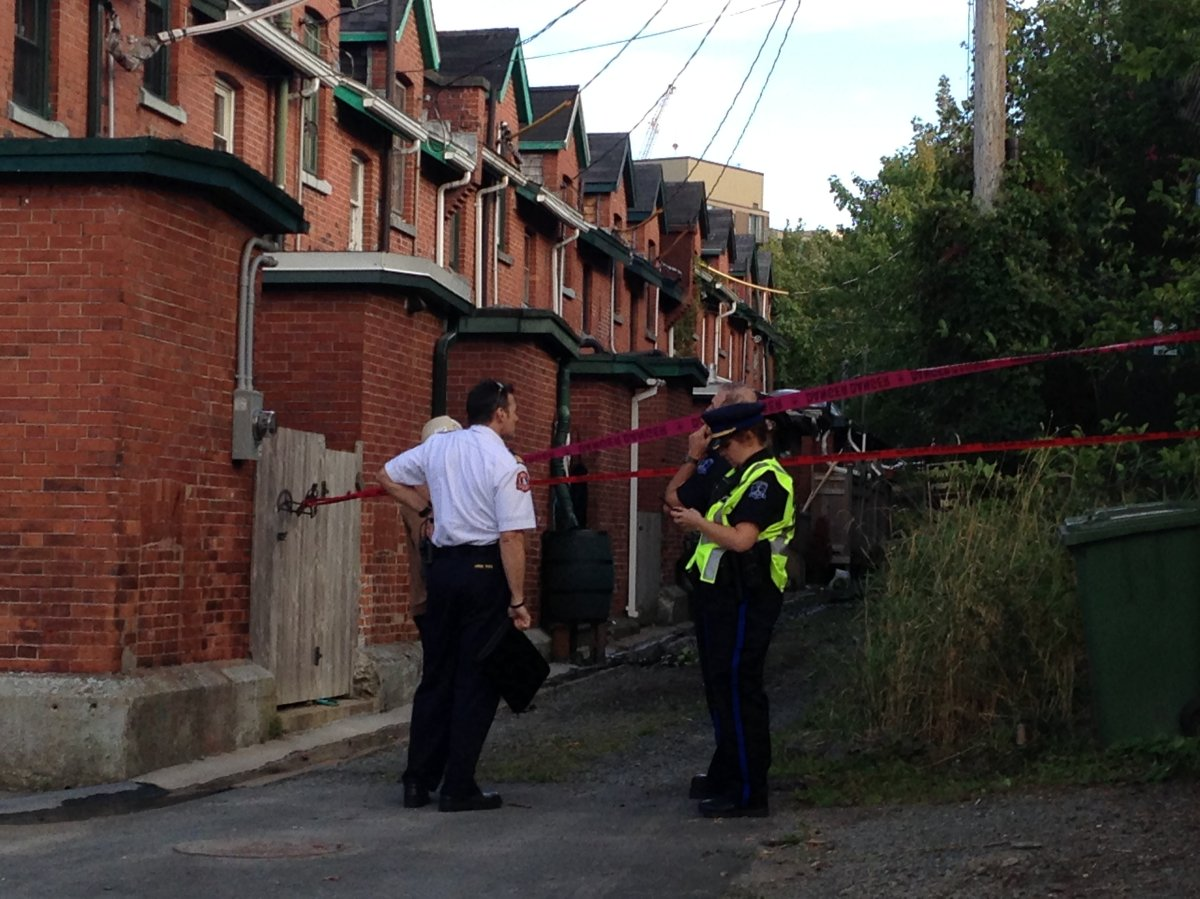 Residents of 12 townhouses next to the scene of a large fire in Halifax have been allowed back in their homes after a two-week evacuation. In this file photo taken on Sept. 15, officials are looking at a wall between the homes and the fire scene.