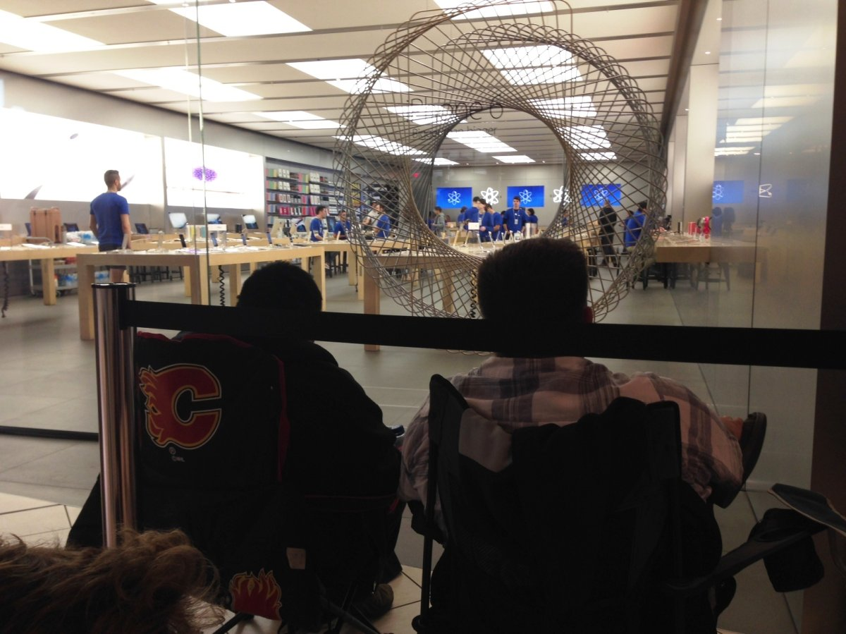 Eager Apple fans lineup outside of the Chinook Centre location ahead of the iPhone 6 release on Friday, September 19, 2014.