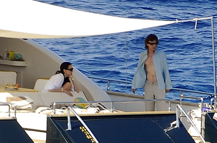 No stranger to yachts, Mick Jagger is pictured here with fashion designer L'Wren Scott board a private yacht on August 13, 2009 in Tuscany, Italy.