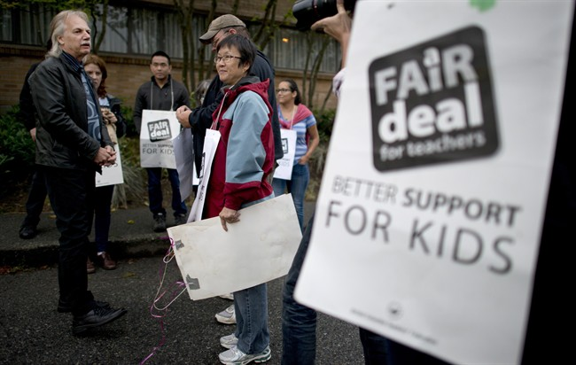 Former British Columbia Teacher Federation (BCTF) President Jim Iker is seen outside the Britannia Secondary and Elementary Schools in Vancouver, Tuesday, Sept. 2, 2014, during the last BCTF strike.