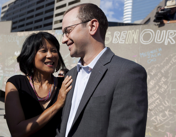 Olivia Chow, left, stands with her stepson Toronto Councillor Mike Layton, right, during a memorial marking the one year anniversary of the passing of her husband Federal NDP Leader Jack Layton in Toronto on Wednesday, August 22, 2012.