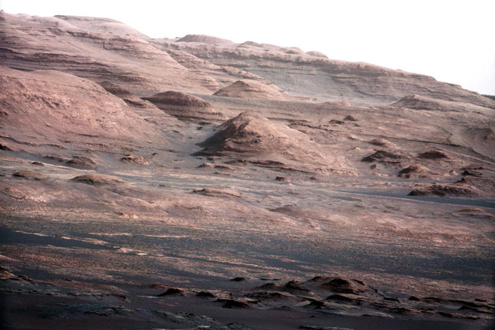 A colour-enhanced image of Mount Sharp from the Curiosity rover.