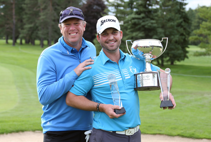 Ryan Williams (R) and caddie Robert Thompson (L) after the fourth round of the PGA Tour Canada Championship at Sunningdale Golf & Country Club on September 14, 2014 in London, Ontario.