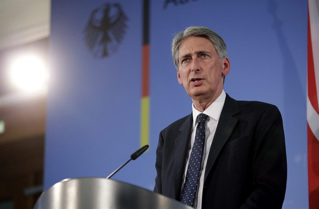 The Foreign Minister of Britain, Philip Hammond addresses the media during a joint press conference with German Foreign Minister Frank-Walter Steinmeier after a meeting in Berlin, Germany, Thursday, Sept. 11, 2014.