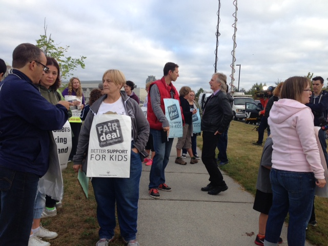 Teachers behind the picket lines at Byrne Creek Secondary in Burnaby .