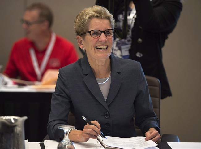 Ontario Premier Kathleen Wynne smiles at the start of a session at the annual Council of the Federation meeting in Charlottetown on Friday, August 29, 2014.