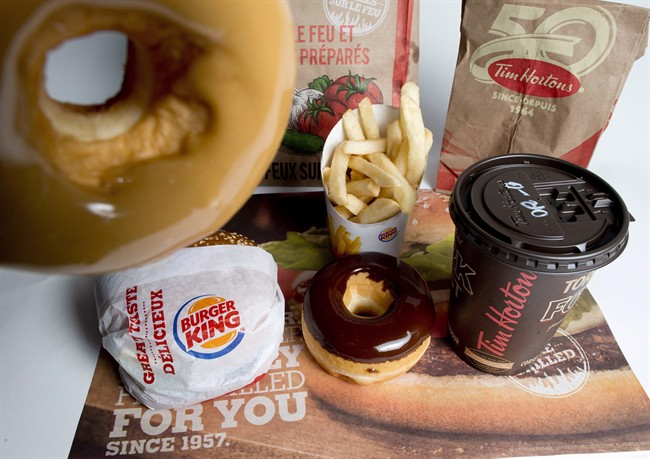 Tims and Burger King will officially become one Dec. 12, the companies said Friday.