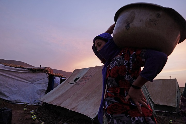 Displaced people from the minority Yazidi sect carry out daily activities at a refugee camp in Zakho near the Syrian border in northern Iraq on October 10, 2014.