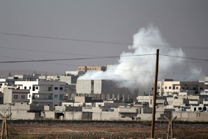 A photograph taken from Suruc district of Sanliurfa, southeastern province of Turkey, shows smoke rises during the clashes between the Islamic State of Iraq and Levant (ISIL) and Kurdish armed troops in Kobane (Ayn al-arab) city of Syria, on October 10, 2014.