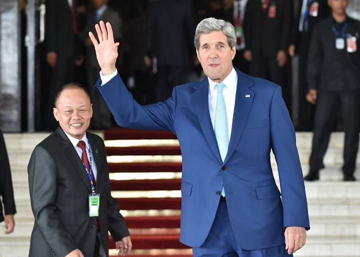 US Secretary of State John Kerry (R) attends the inaugural ceremony of new Indonesian President Joko Widodo at the House of Representative in Jakarta on October 20, 2014.  Widodo, 53, popularly known by his nickname Jokowi, Indonesia's first leader without deep roots in the era of dictator Suharto, is sworn in as president but faces huge challenges to enact a bold reform agenda.