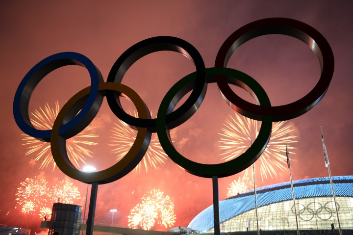 Fireworks explode around the Fisht Olympic Stadium at the end of the Closing Ceremony of the Sochi Winter Olympics on February 23, 2014 at the Olympic Park in Sochi.