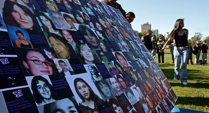 Photographs of missing or murdered women are displayed during a Sisters in Spirit vigil to honour the lives of missing and murdered aboriginal women in Vancouver, B.C., on Sunday October 4, 2009.