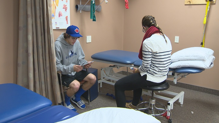 A minor hockey player goes through a baseline concussion test.