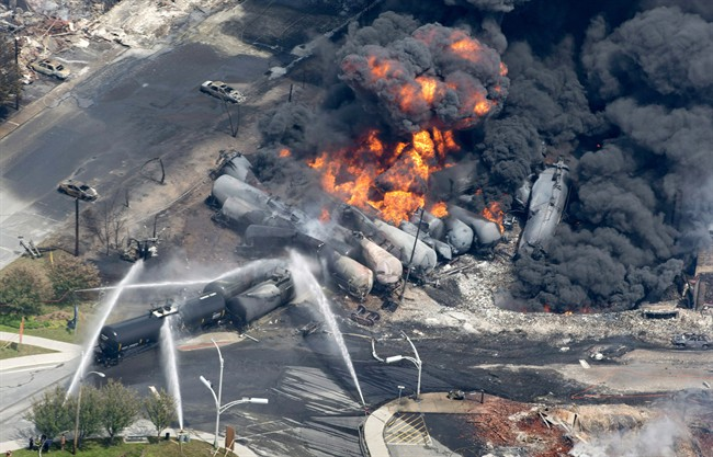 Smoke rises from tanker cars in downtown Lac-Megantic, Que. on July 6, 2013.