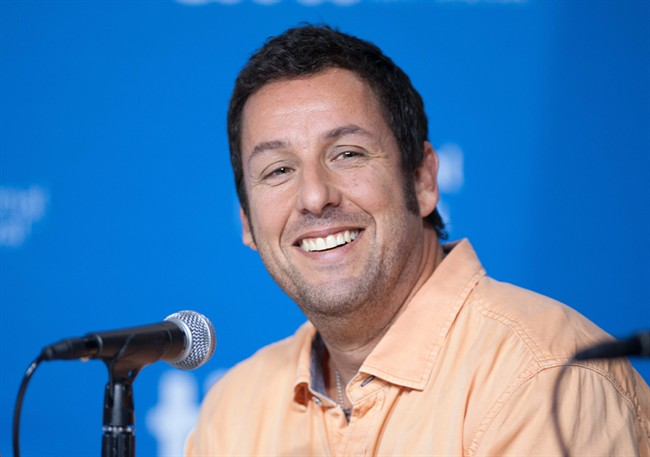 Actor Adam Sandler smiles during a press conference at the Toronto International Film Festival in this Sept. 6, 2014 file photo.