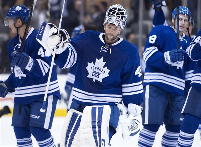 Toronto Maple Leafs goaltender Jonathan Bernier salutes the crowd after a 4-0 win over the Buffalo Sabres in NHL action in Toronto on Tuesday October 28, 2014. THE CANADIAN PRESS/Frank Gunn.