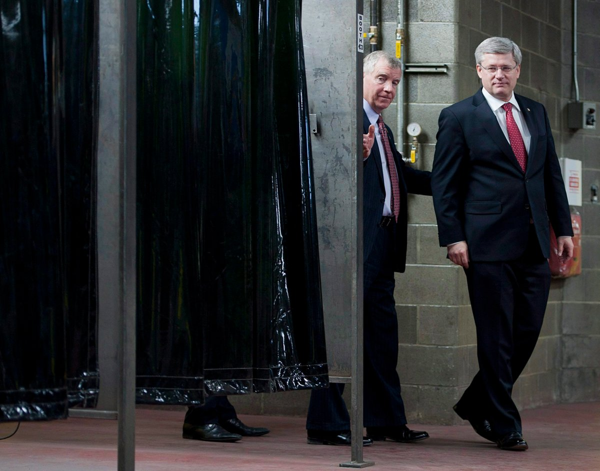 Canadian Prime Minister Stephen Harper, right, and MP Laurie Hawn. THE CANADIAN PRESS/John Ulan.