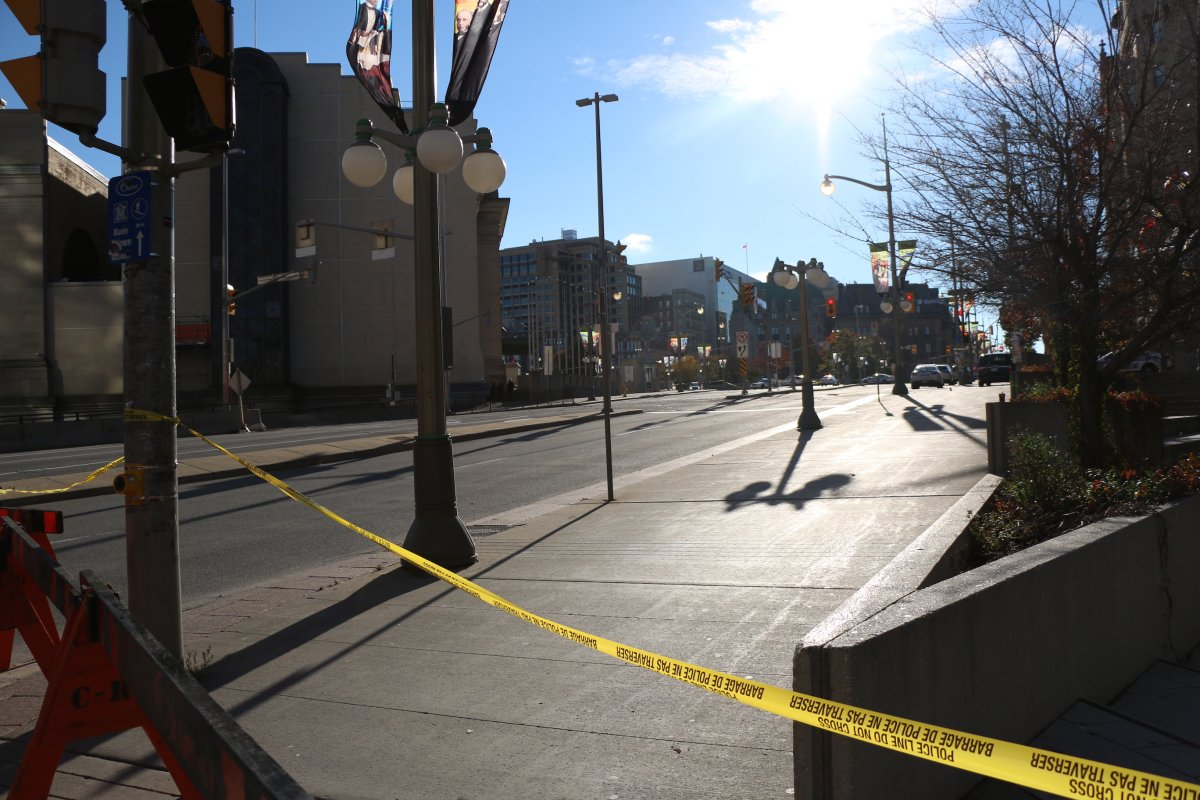 Ottawa's Wellington Street remained behind a police cordon late Wednesday afternoon after a fatal shooting at the War Memorial.