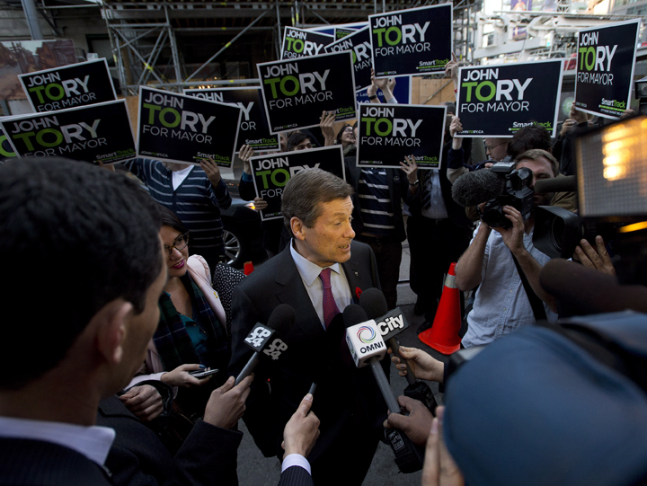 John Tory speaks to the media as he arrives during the final mayoral debate for the Toronto mayoral race in Toronto on Thursday, October 23, 2014.