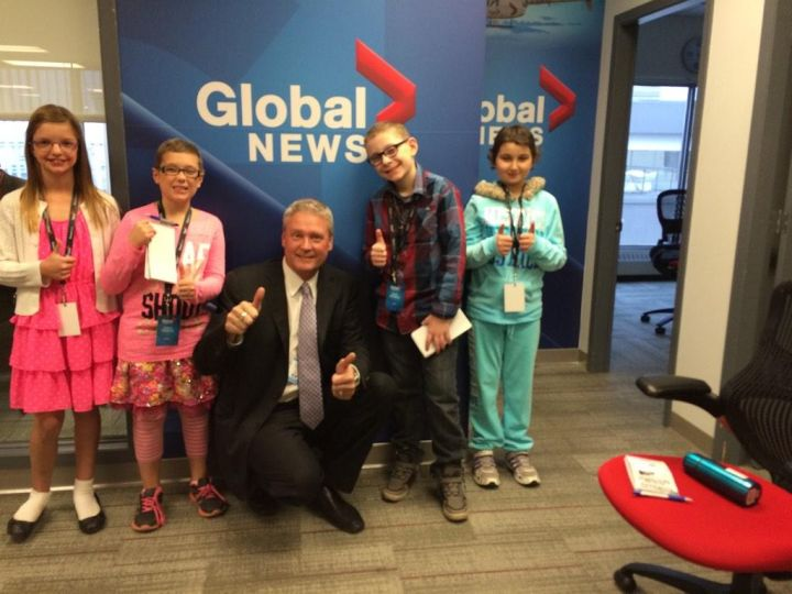 Kaylee, Justice, Gord Steinke, Dance and Mallak in the Global Edmonton newsroom.