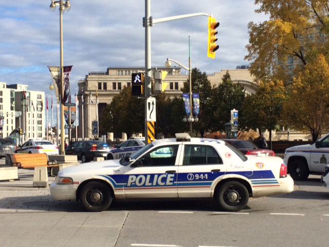 Police respond after a soldier was shot and killed near the War Memorial in Ottawa.