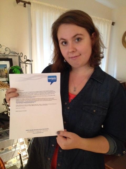 Alannah Clark and her scholarship letter.