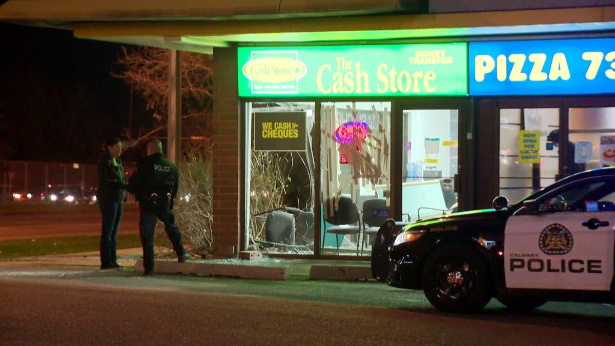 Police investigate a robbery at The Cash Store in the 3700 block of Memorial Drive S.E. on Wednesday, October 29, 2014.