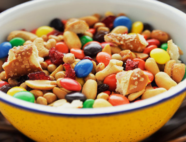 "Are you grazing away on pre-packaged trail mix, granola bars, and other seemingly healthy snacks because they're good for you? New research is warning that food with ""fitness branding"" may be misleading consumers into eating more and exercising less."