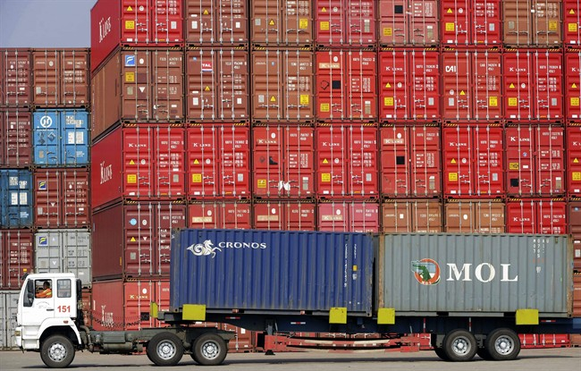 The Pacific Maritime Association said Thursday that the union isn't dispatching enough workers at the twin ports of Los Angeles and Long Beach to load containers efficiently onto trucks and trains. On Monday, the association said crane operators with the International Longshore and Warehouse Union in Washington state are moving cargo at half-speed.