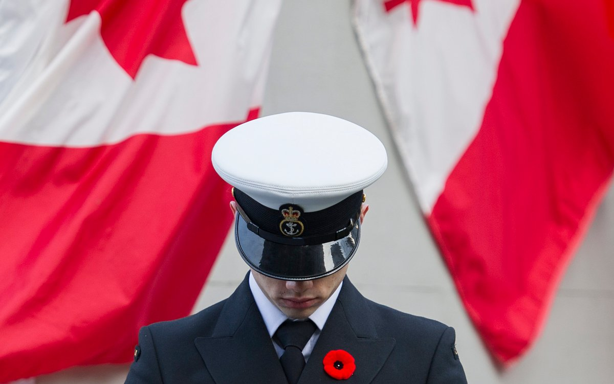 A member of the Canadian forces stands to attention during Remembrance Day ceremonies in Montreal, Tuesday, November 11, 2014.