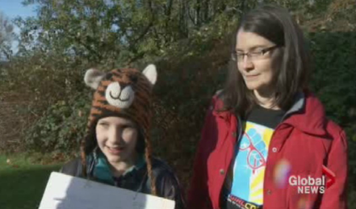 Kate Fink-Jensen, 11, and mother Kim were among the protesters at Burnaby Mountain on Nov. 23.