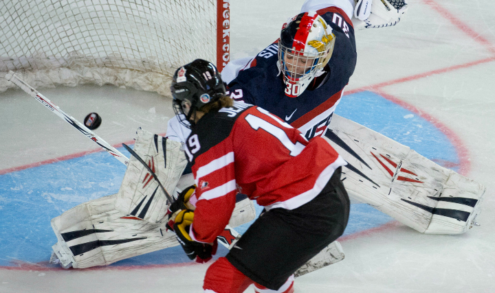 Canada's Brianne Jenner scores the game-winning goal past United States goaltender Molly Schaus during the shootout in the gold medal game of the Four Nations Cup women's hockey tournament in Kamloops, B.C. Saturday, Nov. 8, 2014.