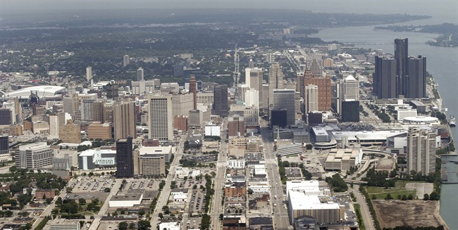 FILE - This July 17, 2013 aerial photo shows the city of Detroit. On Friday, Nov. 7, 2014, federal bankruptcy judge Steven Rhodes is expected to decide whether Detroit's plan to exit bankruptcy is fair and feasible. (AP Photo/Paul Sancya, File).