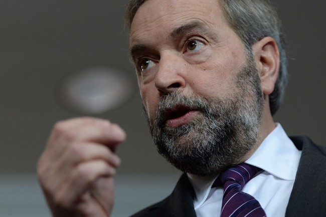 NDP Leader Tom Mulcair answers a question during a press conference in Ottawa on Nov. 19, 2014.