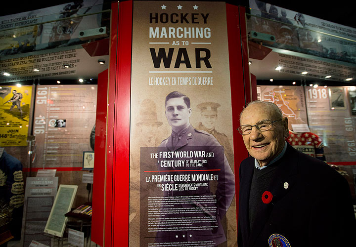 Canadian Second World War veteran and hockey hall of fame inductee Johnny Bower poses for a new photograph at the new exhibit dedicated to First World War and Second World War veterans at the Hockey Hall of Fame in Toronto on Monday, November 10, 2014.