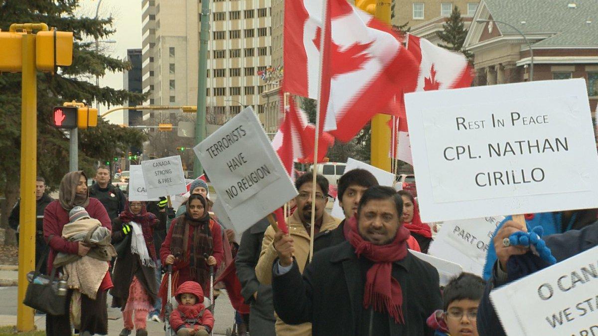Members of Regina's Muslim community marched on sidewalks downtown on Saturday.
