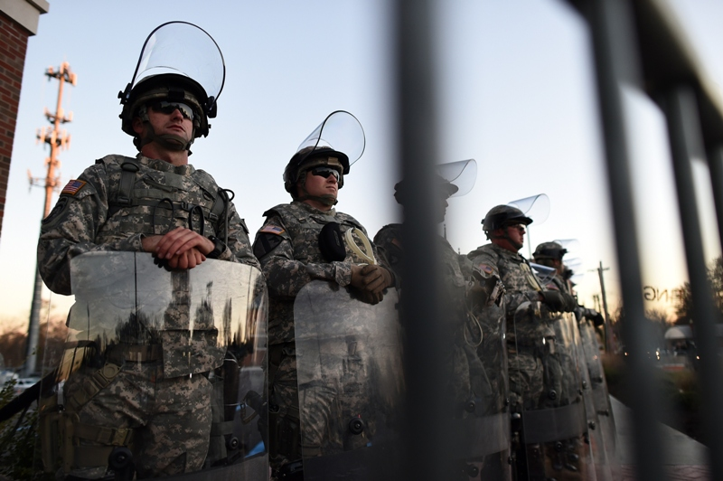 National Guard troops secure the police station in Ferguson, Missouri, a day after violent protests and looting following the grand jury decision in the fatal shooting of an 18-year-old black teenager Michael Brown.