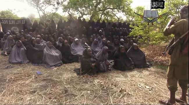 This Monday, May 12, 2014 file image taken from video by Nigeria's Boko Haram terrorist network, shows the alleged missing girls abducted from the northeastern town of Chibok.